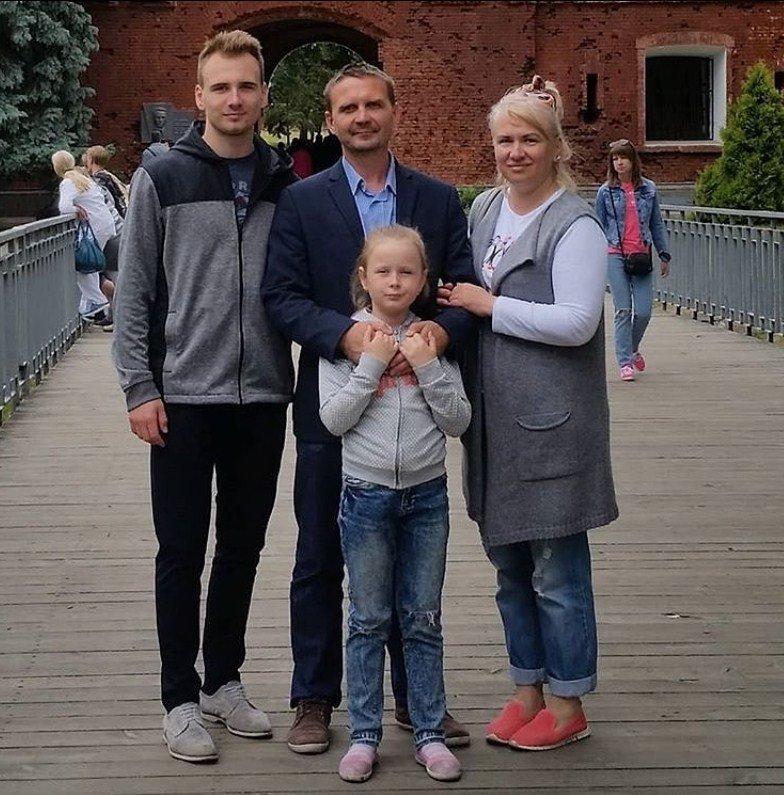 Ilya Usov with his family in Belarus